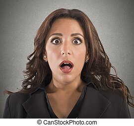 Shocked expression - Portrait of business woman with ...
