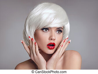 Shocked face. Blond Woman with red lips and manicure nails...