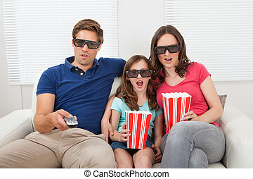 Shocked Family Watching 3D Movie At Home