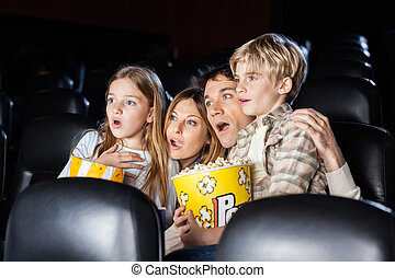 Shocked Family Watching Movie In Theater