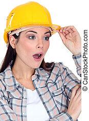 Shocked female construction worker