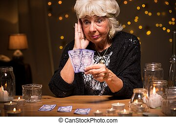 Shocked fortune teller reading cards - Picture of shocked...