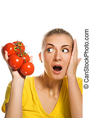 Shocked girl with fresh tomatoes