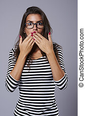 Shocked girl with hands on her mouth