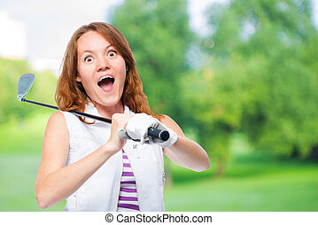 Shocked golfer looking behind the trajectory of a ball flying on a background of golf courses