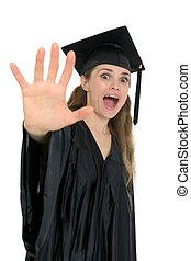 Shocked graduation student woman