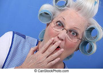 Shocked grandma with hair rollers