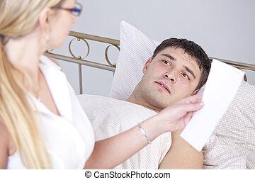 Shocked man after diagnostic report - Shocked man on bed...