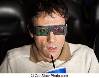 Shocked Man Drinking Cola While Watching 3D Movie