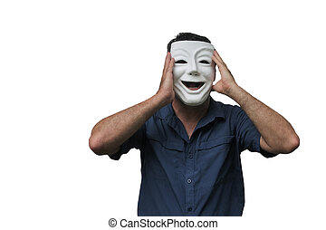 Shocked man wearing a happy face mask with hands holds his face