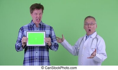 Shocked mature Japanese man doctor with crazy young man...