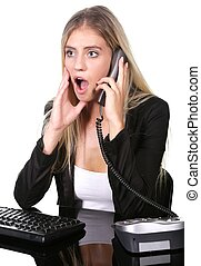 Shocked or Surprised Blonde Office Lady at her Desk
