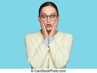 Surprised beautiful woman wearing glasses