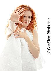 Shocked redhead woman
