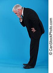 Shocked senior businessman