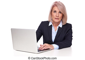 shocked senior businesswoman with laptop