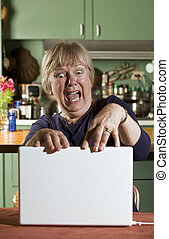 Shocked Senior Woman with a Laptop Computer
