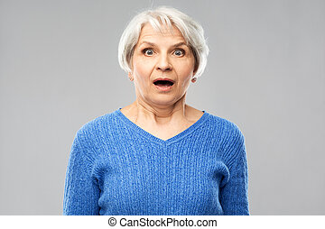 shocked senior woman with open mouth
