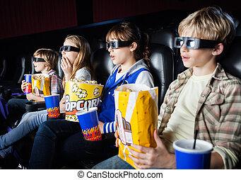 Shocked Siblings Watching 3D Movie In Theater