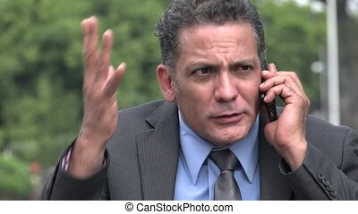 Shocked Stressed Businessman Using Cell Phone