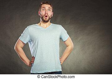 Shocked surprised amazed handsome man guy.
