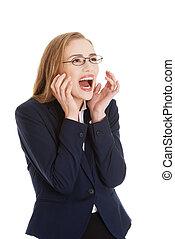Shocked, surprised beautiful business woman.