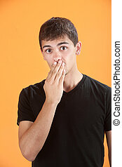 Shocked Teen - Latino teen with hand on his mouth