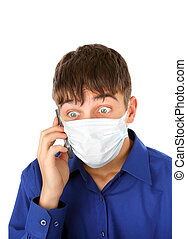 Shocked Teenager in Flu Mask