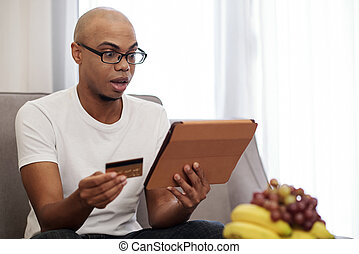 Black man shocked with high price of service he was going to pay for online