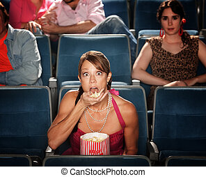 Shocked Woman Eats Popcorn