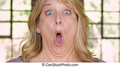 Shocked woman expressing her surprise with her mouth open...