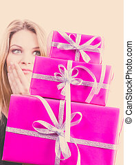 Shocked woman holding gifts