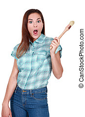 Shocked woman holding paint brush