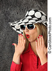 Shocked woman in a hat