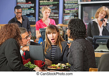 Shocked Woman in Cafe