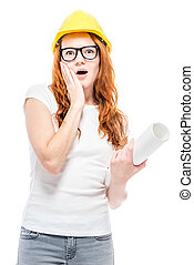 shocked woman in yellow helmet in studio posing