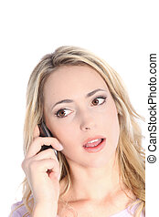 Shocked woman listening to her mobile