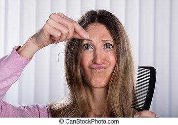 Shocked Woman Losing Hair