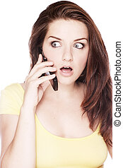 Shocked woman on the phone - A beautiful young woman on her ...
