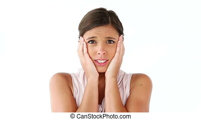 Shocked woman placing her hands on her cheeks