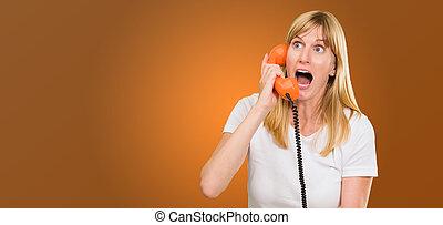 shocked woman talking on telephone