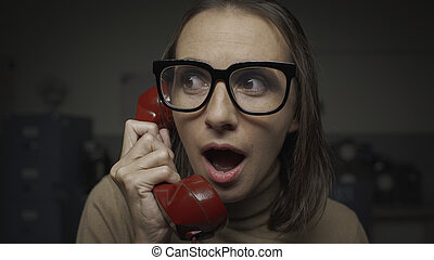 Shocked woman talking on the phone