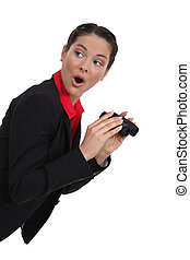 Shocked woman with a pair of binoculars