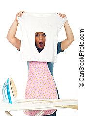 Shocked woman with burned iron shirt