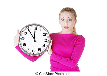 Shocked woman with clock