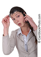 Shocked worker with mobile telephone