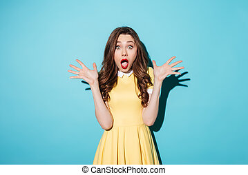 Shocked young brunette woman