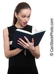 shocked young business woman looking at diary