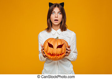 Shocked young woman dressed in crazy cat halloween costume