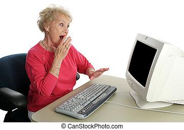 Shocking Content - A senior woman viewing shocking internet ...